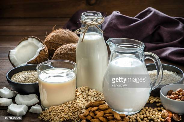 various kinds of vegan milk - milk stock pictures, royalty-free photos & images