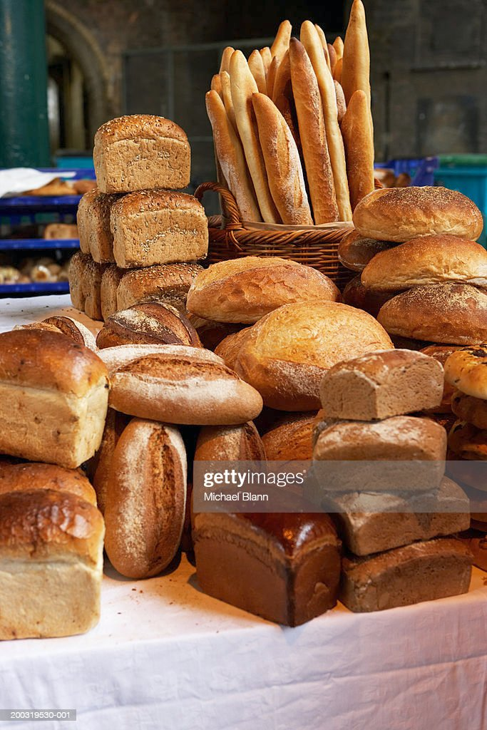 Various loaves piled on market stall : Stock Photo