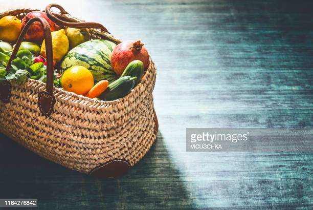 various local markt fruits and vegetables in rattan wicker shopping bag - food and drink stock pictures, royalty-free photos & images