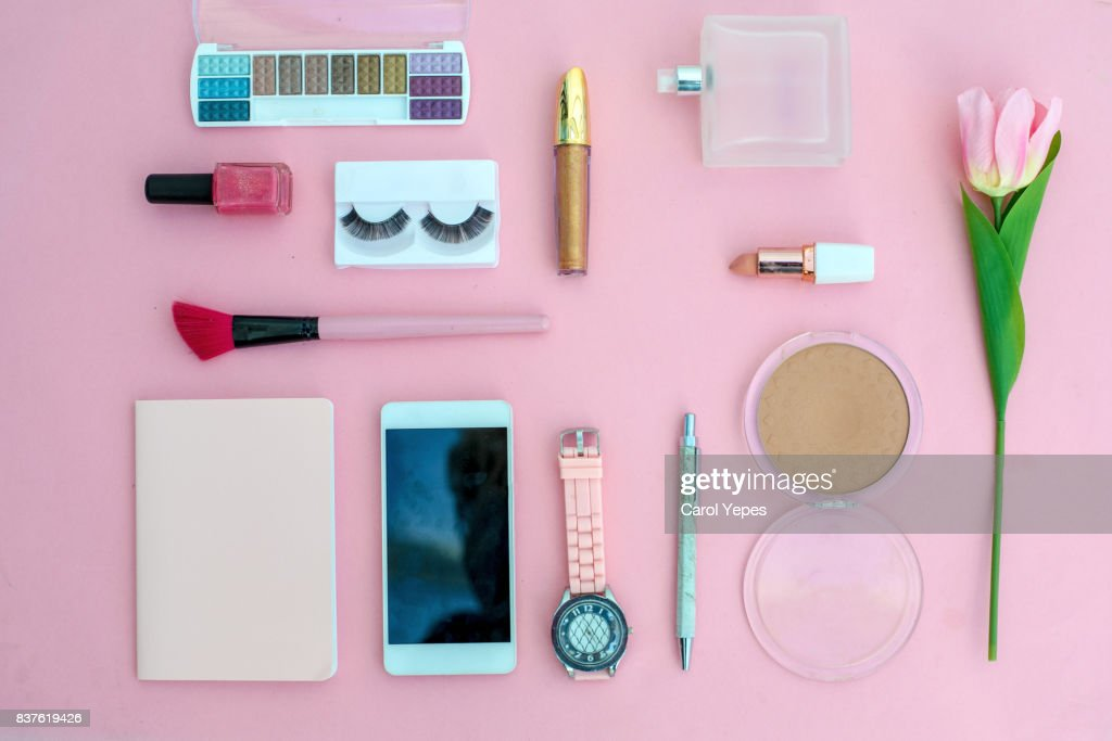 various makeup products and cosmetics in pink background.Top view : Stock Photo