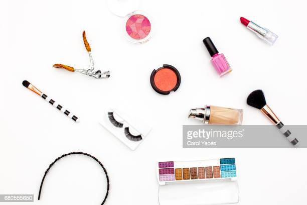 various makeup products and cosmetics in white background.Top view