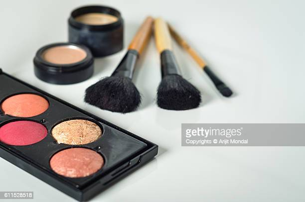 Various Makeup Products in White Table with extra blank space