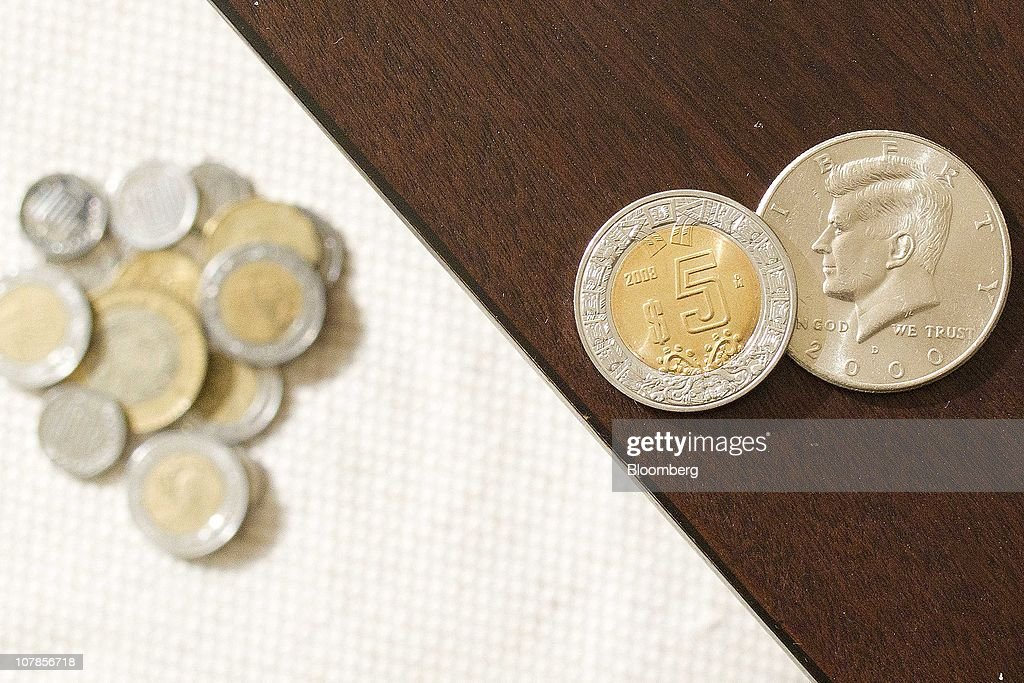 Various Mexican peso coins and a $0 50 U S  coin are