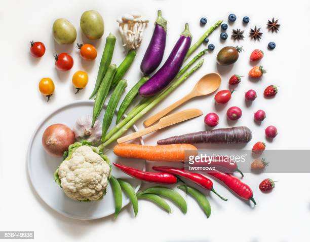 various multi colour vegan food on rustic wooden counter top. - vegan food stock photos and pictures