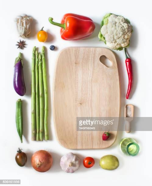 Various multi colour vegan food on white background.