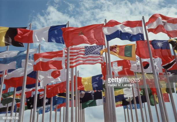 various national flags against sky - national flag stock pictures, royalty-free photos & images
