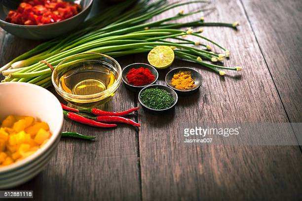 Various of spices and vegetable on dark rustic wooden background