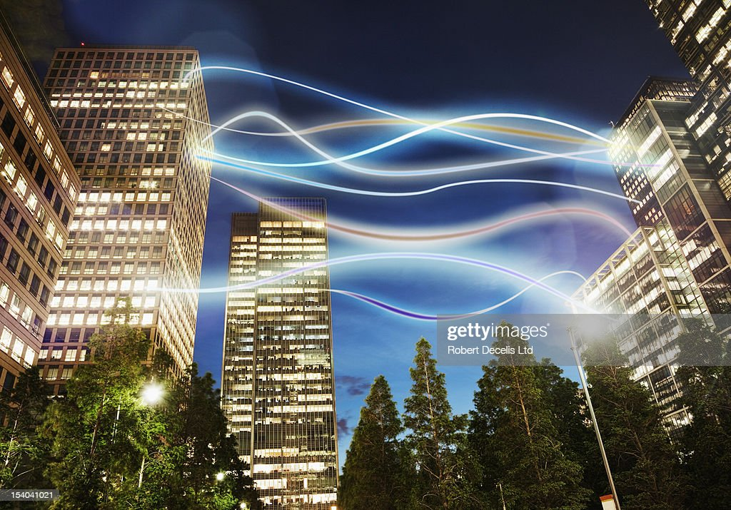 various offices connected via light trails in city : Foto stock