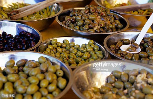 Various olives in bowls, elevated view, close-up