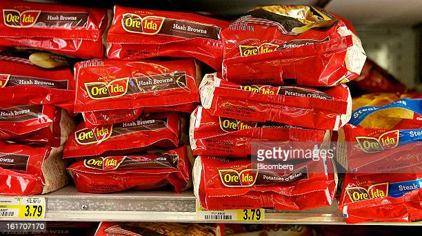 Various OreIda products made by HJ Heinz Co are displayed in a freezer for sale at grocery store in Pittsburgh Pennsylvania US on Thursday Feb 14...