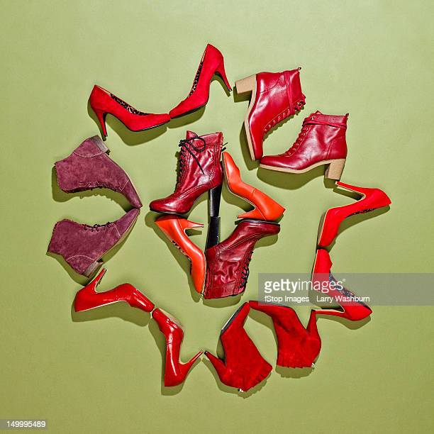 Various pairs of red shoes arranged in a pattern