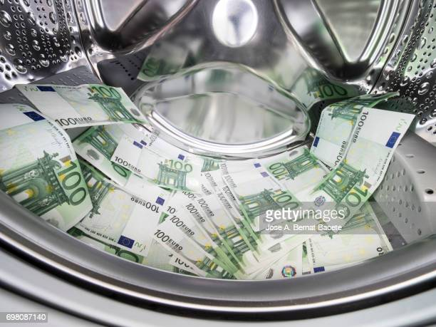 Various paper currencies from 100 euros Inside a washing machine
