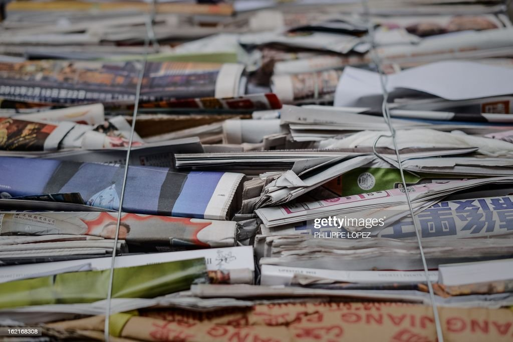 Various papers from newspapers and magazines are compressed before recycling in Hong Kong on February 20, 2013. Activists have claimed for years that Hong Kong lags behind the rest of the world on environmental issues ranging from recycling to lanes for cyclists. AFP PHOTO / Philippe Lopez