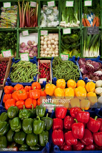 Various peppers shown on a market