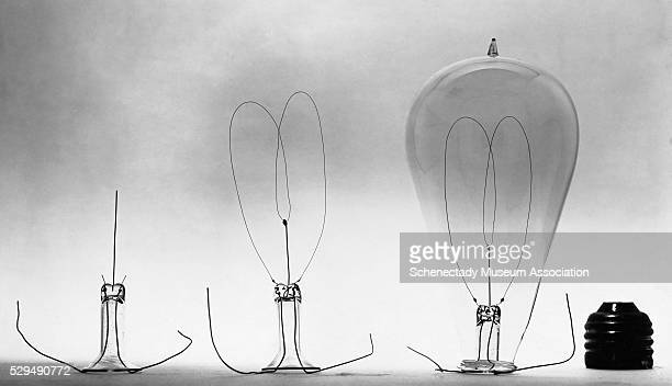 Various pieces of an incandescent light bulb a completed stem completed mount an exhausted bulb and the base of a gem lamp