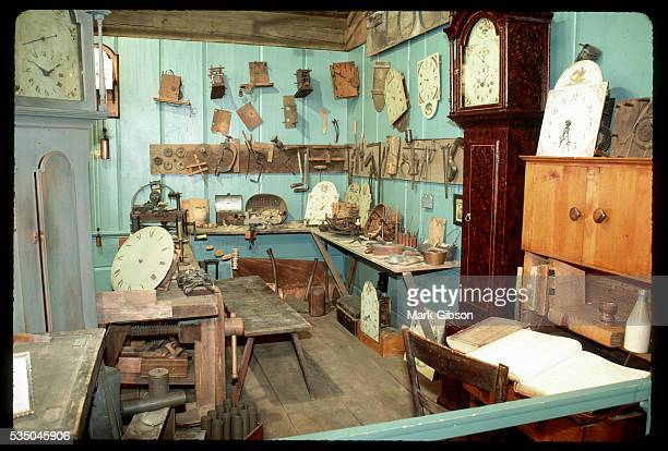 Various pieces of clocks and clock mechanisms hang on the walls and sit on the worktables in a display at the American Clock Watch Museum Bristol was...