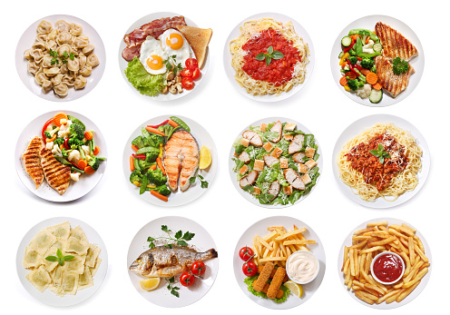 various plates of food isolated on white background, top view 1058241232