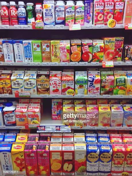 various products arranged on rack in store - 収納ラック ストックフォトと画像