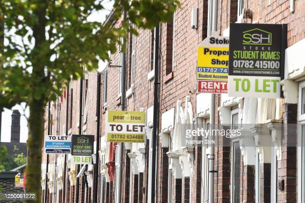 Various property signs are seen outside a block of terraced houses advertising homes for sale, let or sold on June 16, 2020 in Stoke-on-Trent. The...