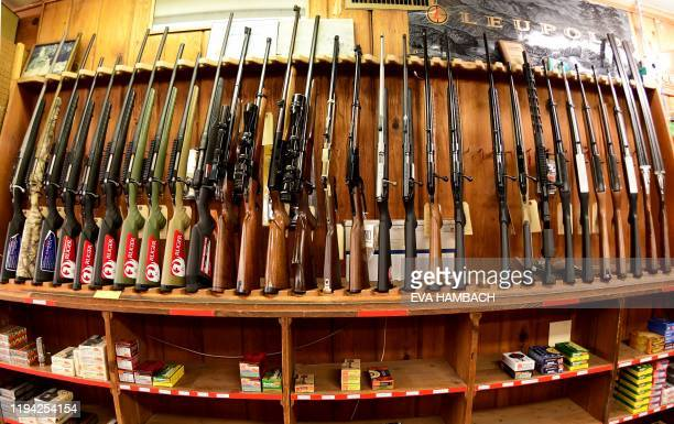 Various rifles are on display at Clark Brothers gun store in Warrenton Virginia some 48 miles from Washington DC on January 16 2020 When Sheriff...