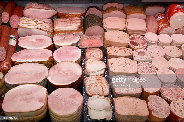 Various sausages display in supermarket, elevated view