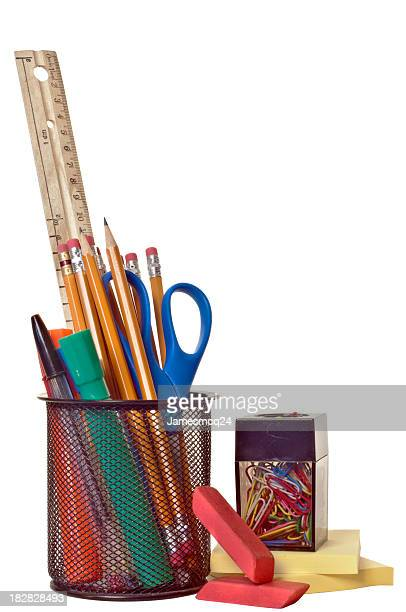 Various school supplies isolated on a white background