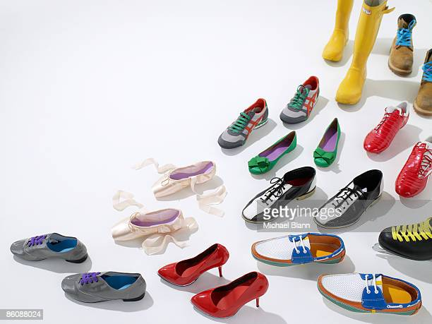 various shoes facing one direction - footwear stock pictures, royalty-free photos & images