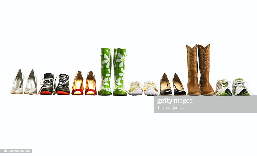 Various shoes in a row, studio shot : Stock Photo