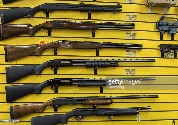 Various shotguns hang on a wall at ABQ Guns in Albuquerque New Mexico US on Thursday Sept 1 2016 The constitutional right of Americans to bear arms...