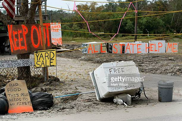 Various sign are seen in front of a home damaged by Hurricane Ike September 19 2008 in Seabrook Texas Hurricane Ike caused wide spread damage and...