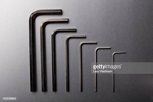 Various sizes of Allen wrenches in a neat row