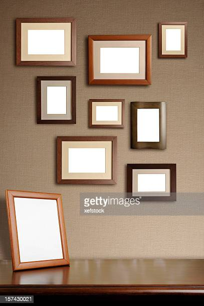 Various sizes of blank wooden picture frames hanging
