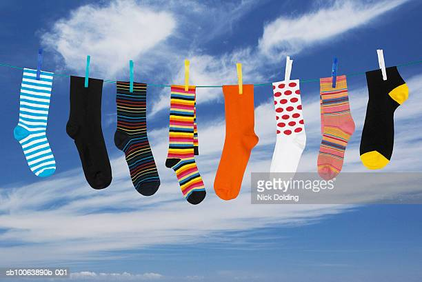 Various socks hanging on washing line