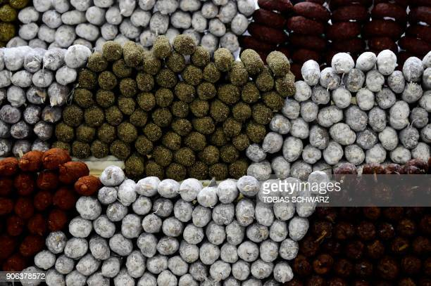 Various sorts of sausage are displayed at the booth of France before the opening day of the International Green Week agricultural fair in Berlin on...