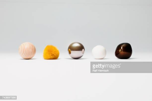 various spherical objects arranged on white background - shape stock pictures, royalty-free photos & images
