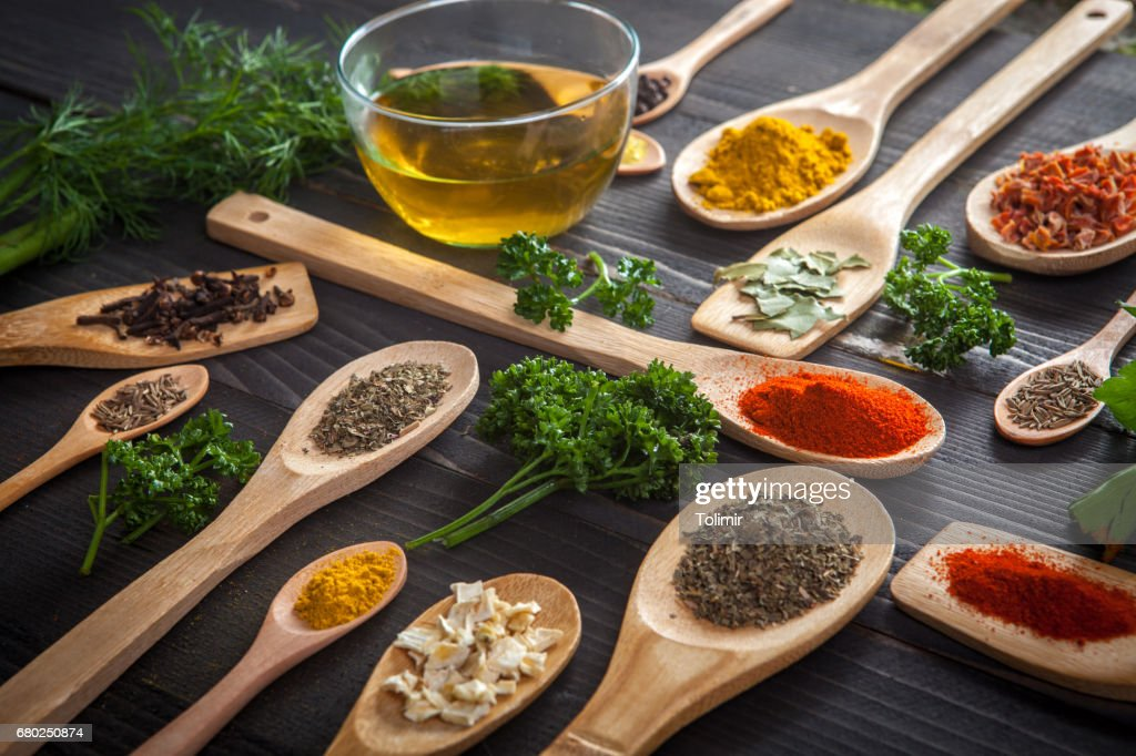 Various spice on wooden spoons with herbs : Stock Photo