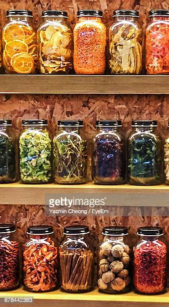 Various Spices In Jars On Shelves At Store