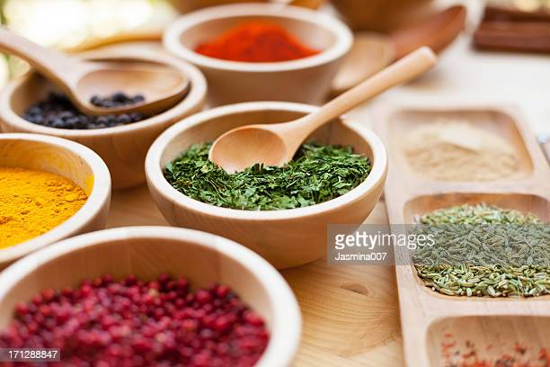 Various spices in wooden bowl
