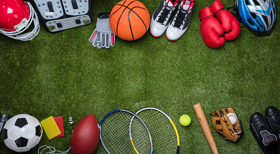 Various Sport Equipments On Grass 949190756