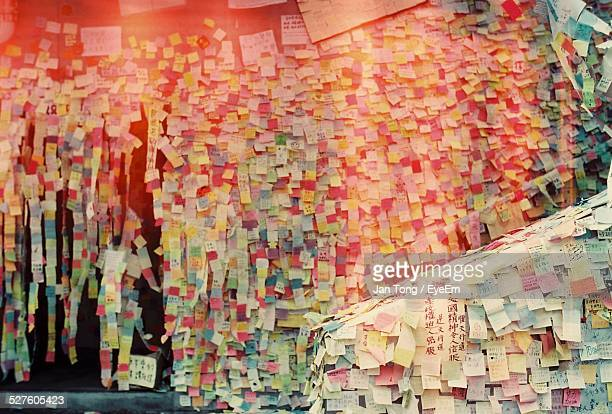 various sticky notes on wall - excess stock photos and pictures