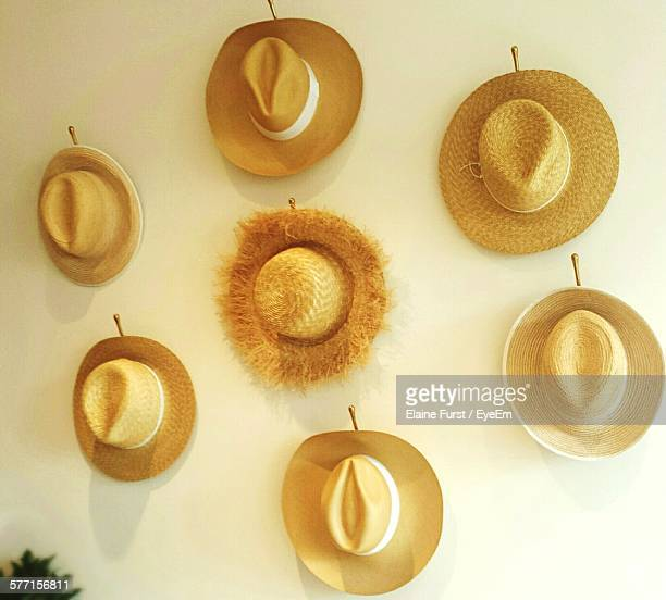 Various Straw Hats Arranged On Wall