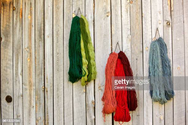 various strings of wool on fence against workshop - 束 ストックフォトと画像