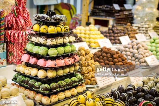 various sweet food for sale at market stall - marzipan stock pictures, royalty-free photos & images