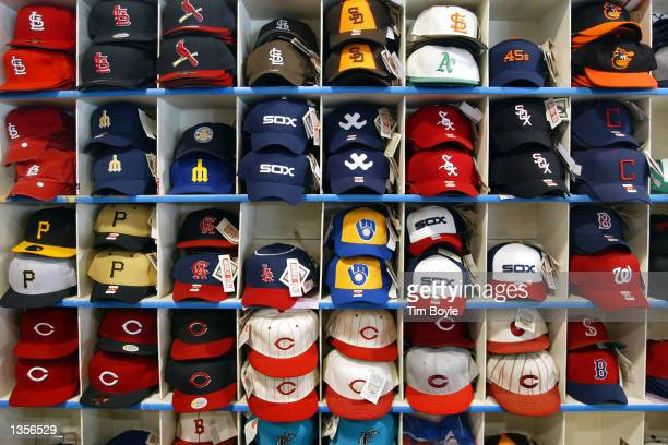 Various team baseball caps are displayed at the Sports World souvenir store across the street from Wrigley Field home of Major League Baseball's...