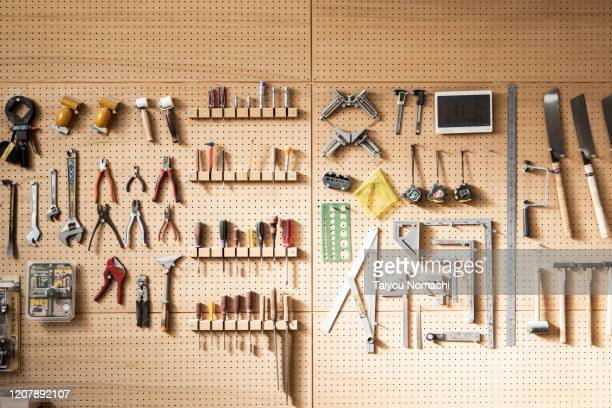 various tools arranged on the wall - werkstatt stock-fotos und bilder
