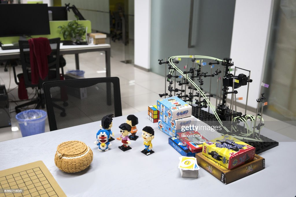 Various toys and card games sit on a table at the Sinovation Ventures headquarters in Beijing, China, on Tuesday, Aug. 15, 2017. SinovationVentures' latest growing endeavor, an in-house AI Institute, has about 30 full-time employees with plans to grow headcount to about a hundred within the year. Photographer: Giulia Marchi/Bloomberg via Getty Images