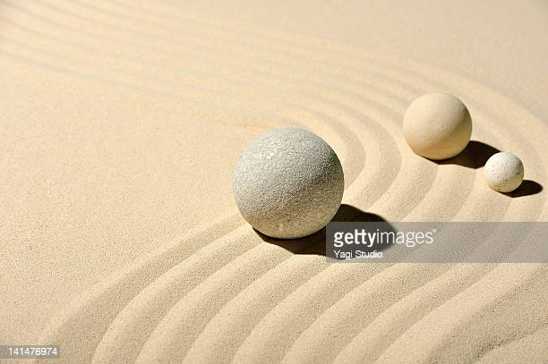 Various types of ball and wave pattern in the sand