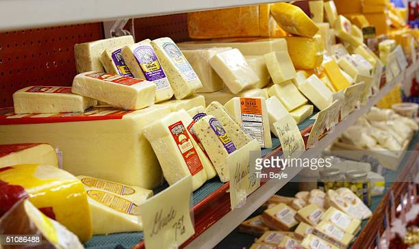 Various types of cheese are displayed at the Home Economist store July 20 2004 in Skokie Illinois Kraft Foods North America's largest food maker...