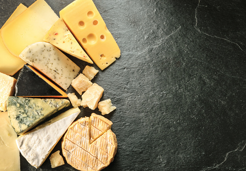 Various types of cheese with empty space background 500454814