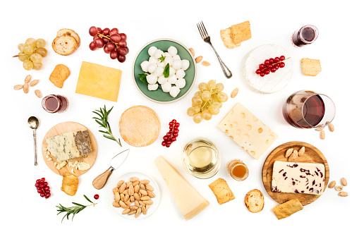 Various types of cheese with wine on a white background 907792774